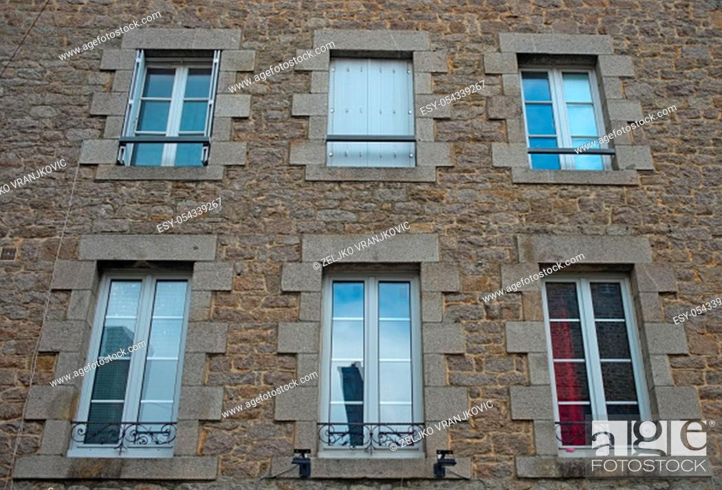 Stock Photo: Traditional french stone building with many windows.