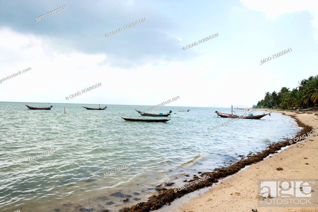 Stock Photo: Fishing boats on shore, Koh Pha Ngan, Thailand.