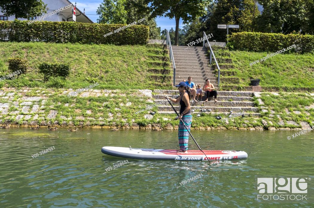 Stock Photo: girl doing paddle surfing, Ljubljanica River, Ljubljana, Slovenia.