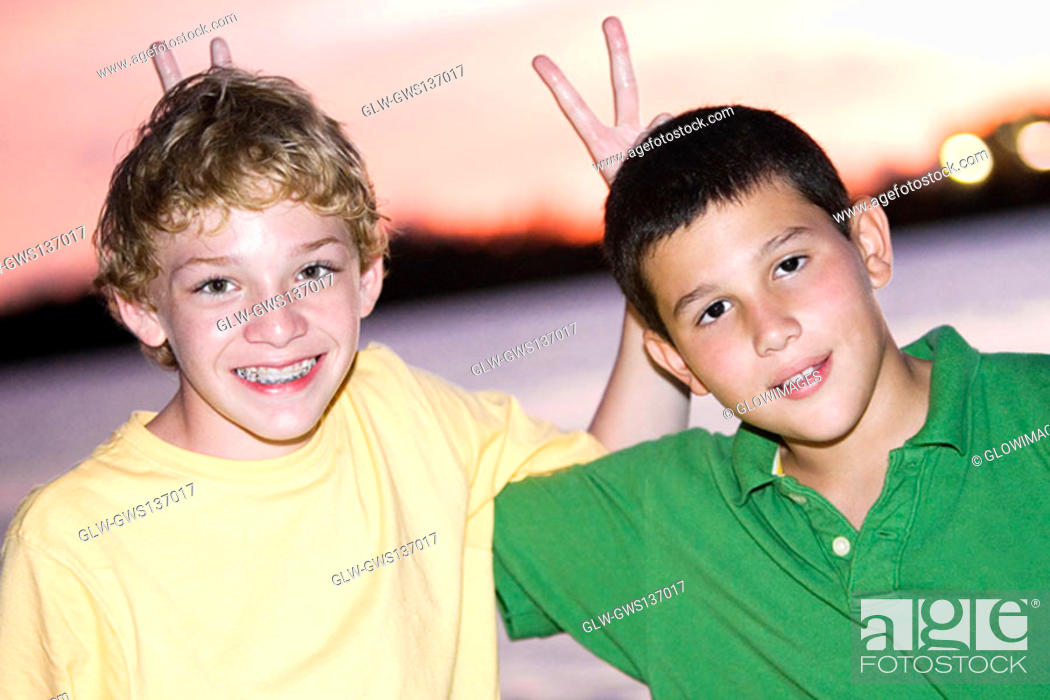 Stock Photo: Portrait of two boys smiling.