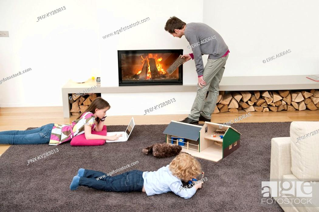 Stock Photo: Family in a living room.