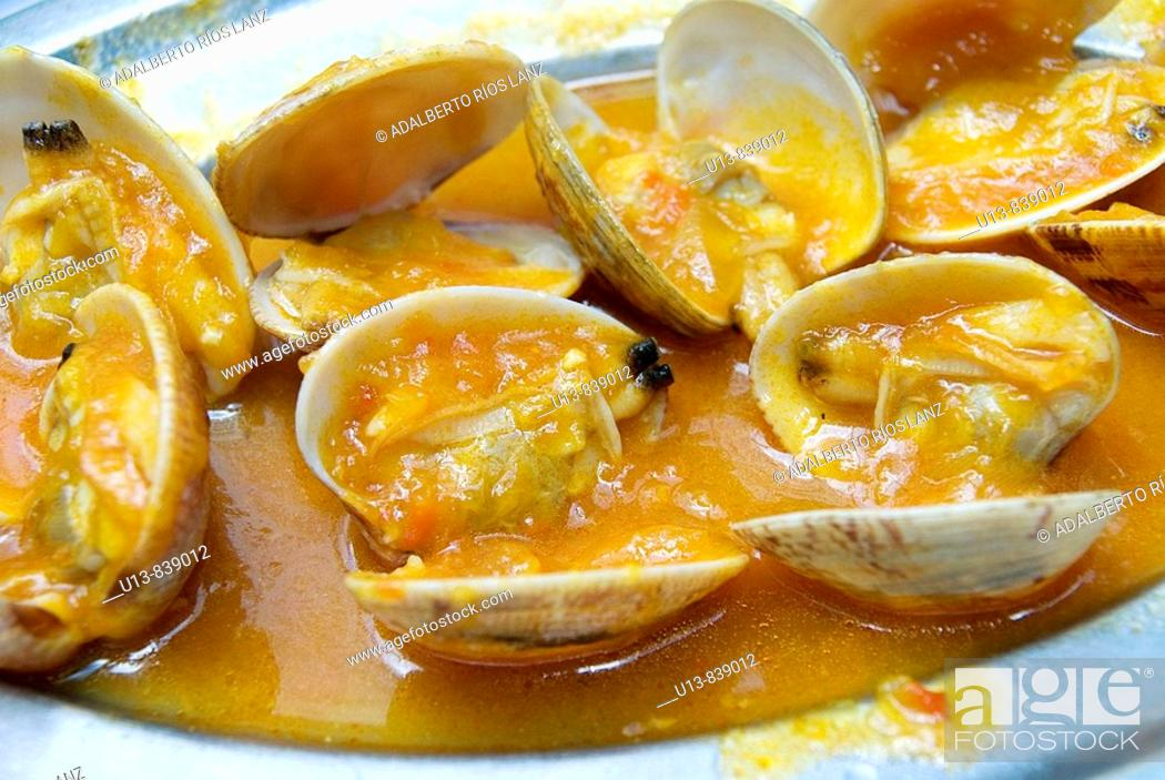 Stock Photo: Oven Cooked Clams With Tomato and Garlic Sauce. Olive Oil. Vigo.