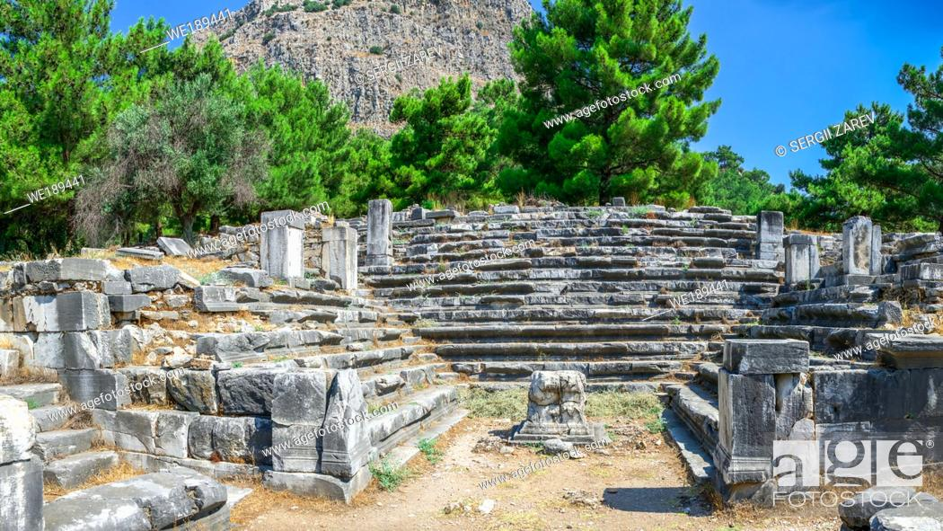 Stock Photo: Ruins of the Bouleuterion or council house in the ancient city of Priene, Turkey, on a sunny summer day.