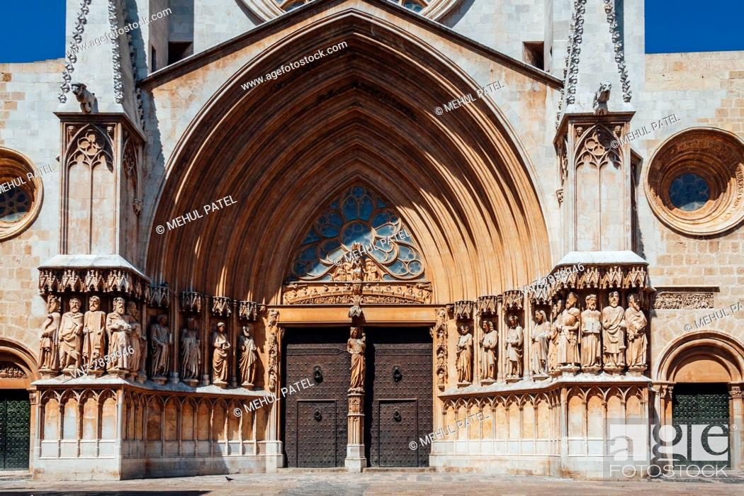 Stock Photo: Front on view of main gate and facade of the Cathedral of Tarragona, Catalonia, Spain. The cathedral is situated in the old town of Tarragona at the city's.