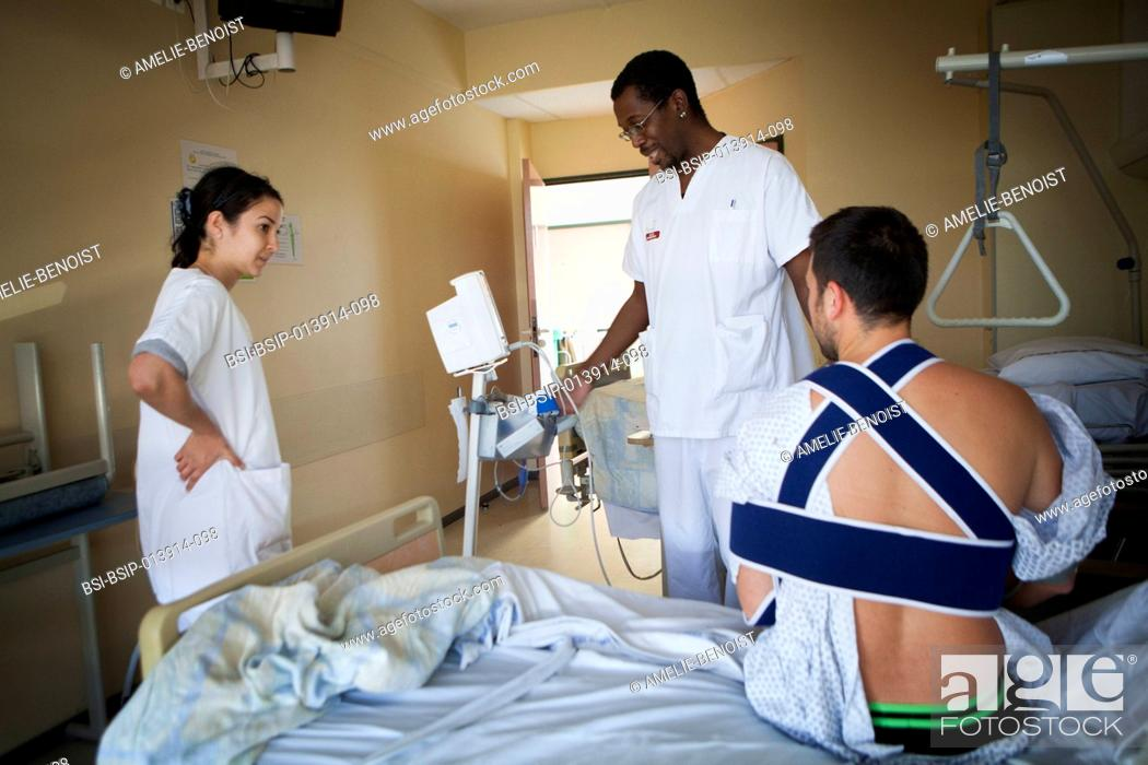 Stock Photo: Reportage in the orthopedic service of robert bellanger hospital in france. nurses.