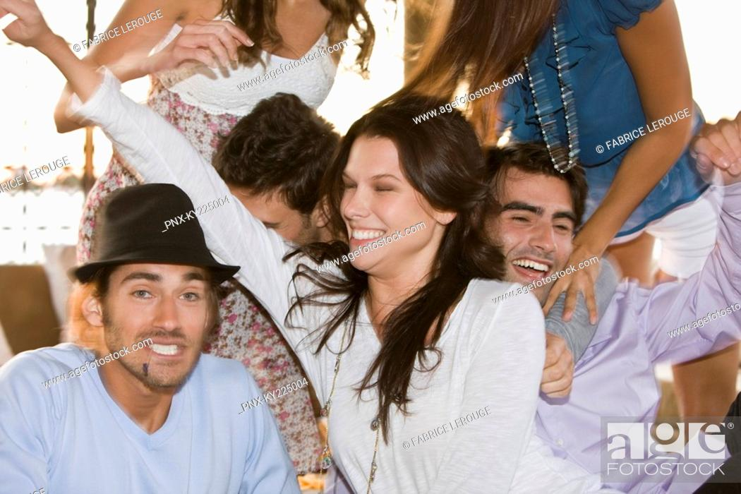 Stock Photo: Group of friends enjoying at a party.