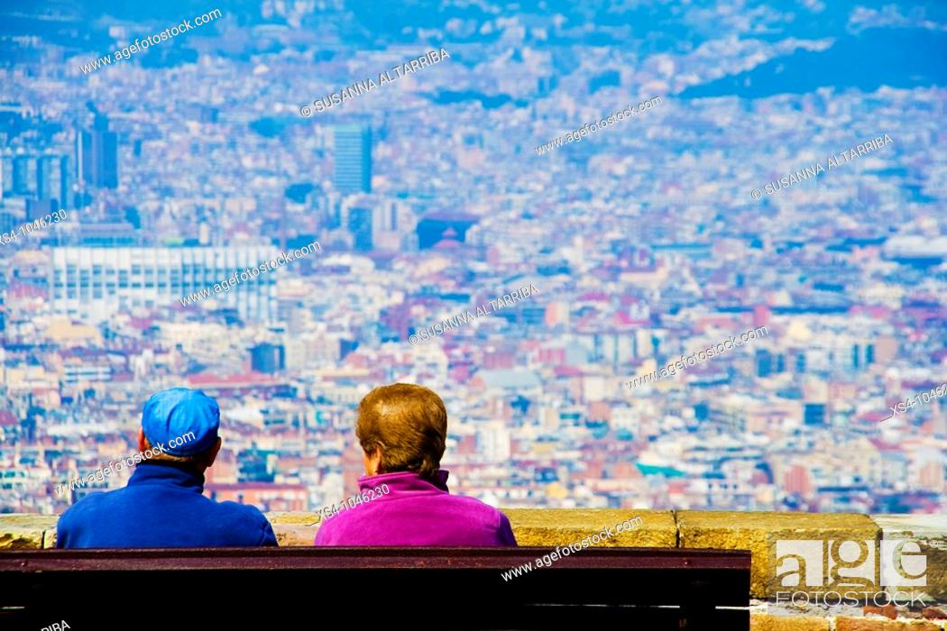 Stock Photo: Contemplating Barcelona City from Montjuic Castle.Europe, Spain, Catalonia.March 2010.