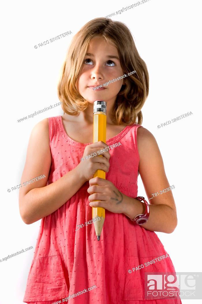 Stock Photo: girl thinking with pencil, studio Valencia, Spain.