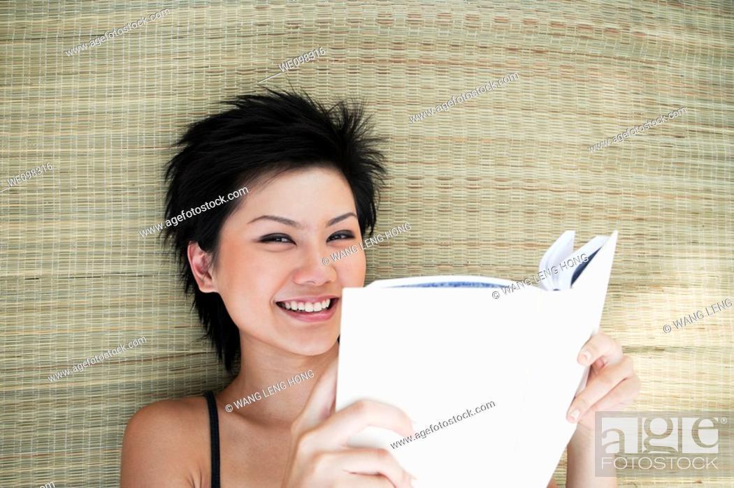 Stock Photo: young asian woman looking at camera.