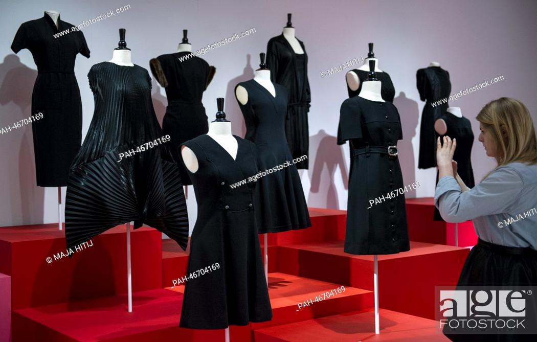 ebbfc7655b0 Stock Photo - A woman takes pictures of the little black dresses during the  exhibition  Myth Chanel