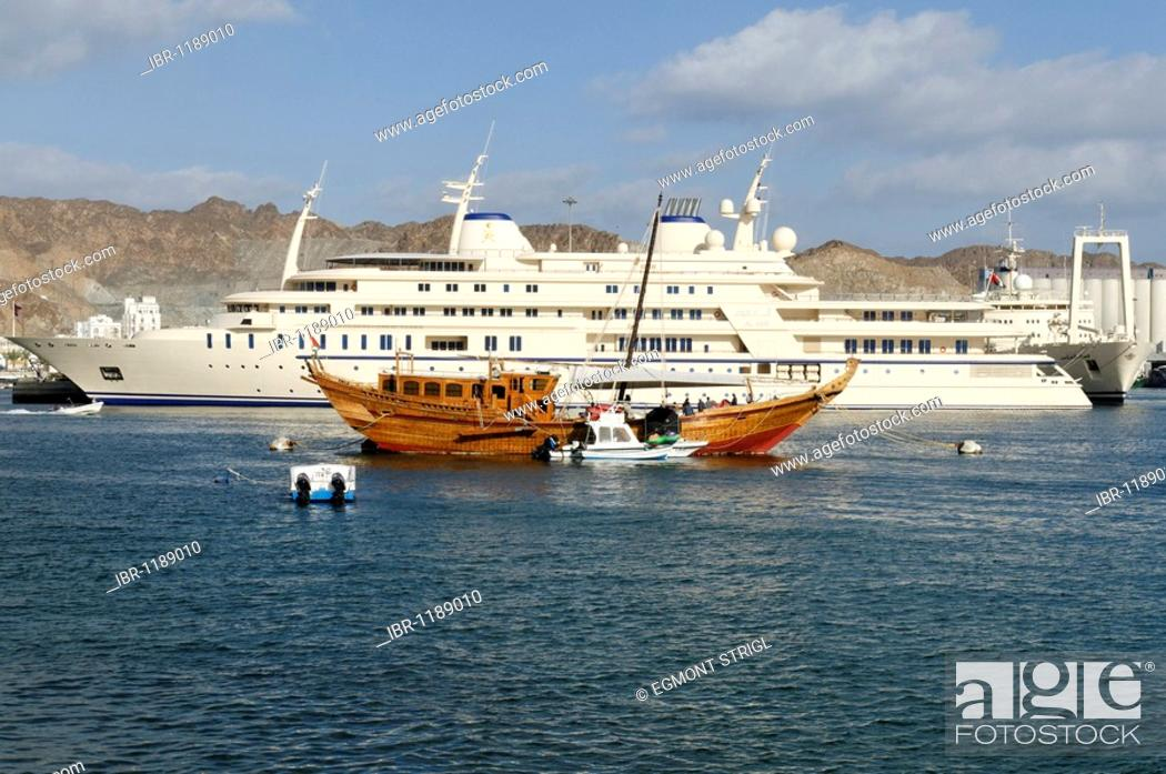 Stock Photo: Old dhow and Sultan Qaboos royal yacht, Mutrah harbour, Muscat, Sultanate of Oman, Arabia, Middle East.