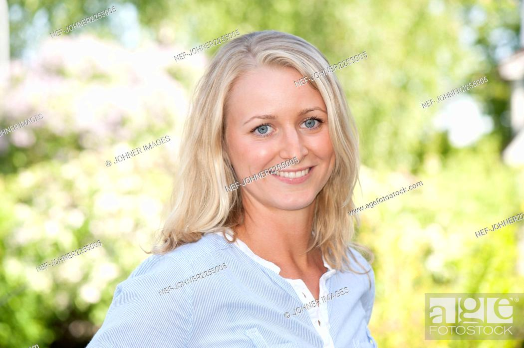 Stock Photo: Portrait of smiling woman.