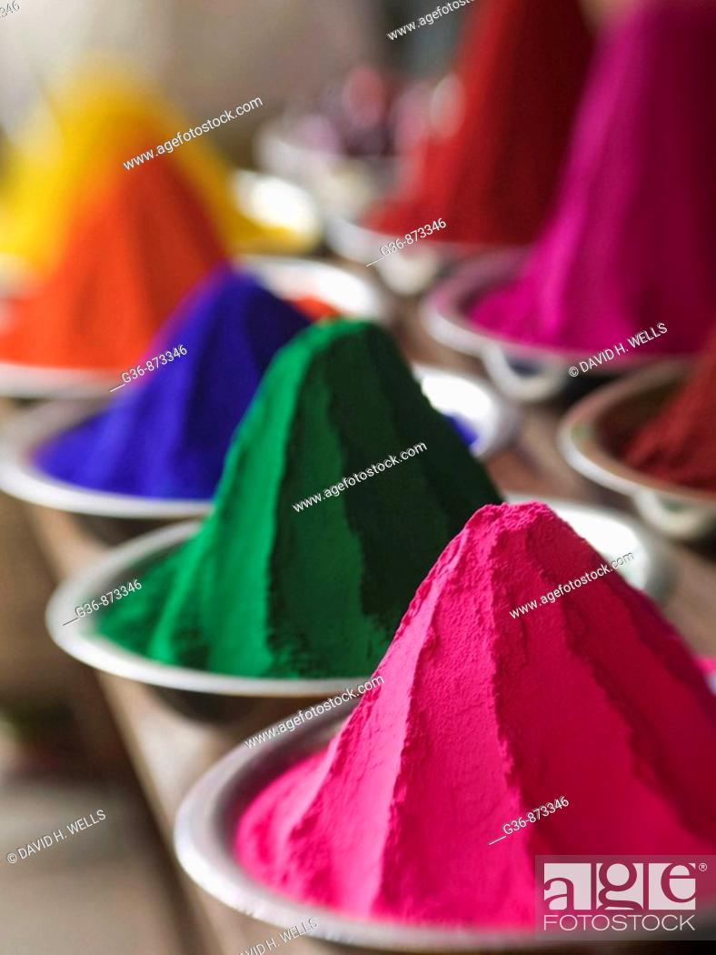Stock Photo: Colored powder used in rituals for sale in the main market in Mysore, Karnataka, India (intentional selective focus).