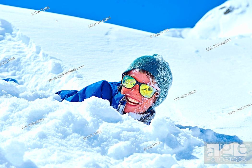 Stock Photo: Boy playing in snow, Chamonix, France.