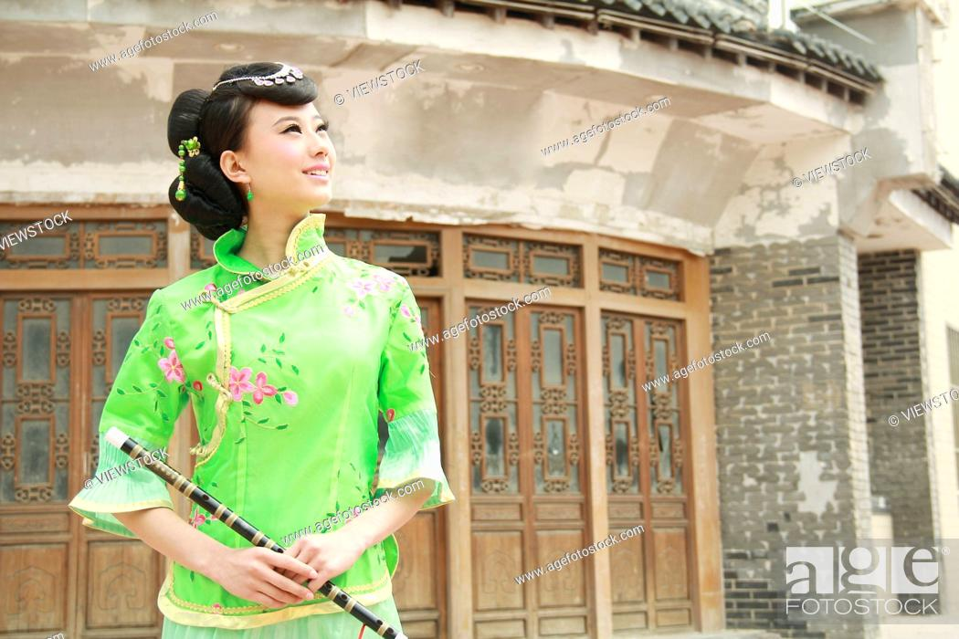 Stock Photo: Beauty costume holding a flute.
