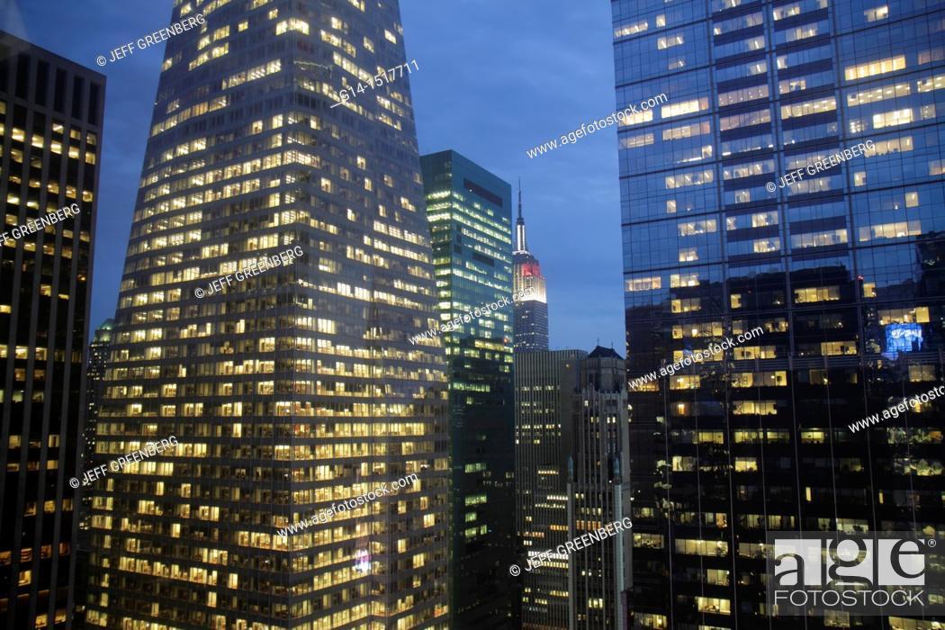 Stock Photo: New York, New York City, NYC, Midtown, Manhattan, Bank of America Towers, skyline, skyscrapers, office buildings, lights, dusk, Empire State, view, urban, night.