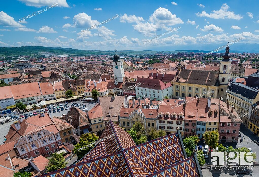 Stock Photo: Old Town with Holy Trinity Church and Council Tower seen from Lutheran Cathedral of Saint Mary in Historic Center of Sibiu, Transylvania, Romania.