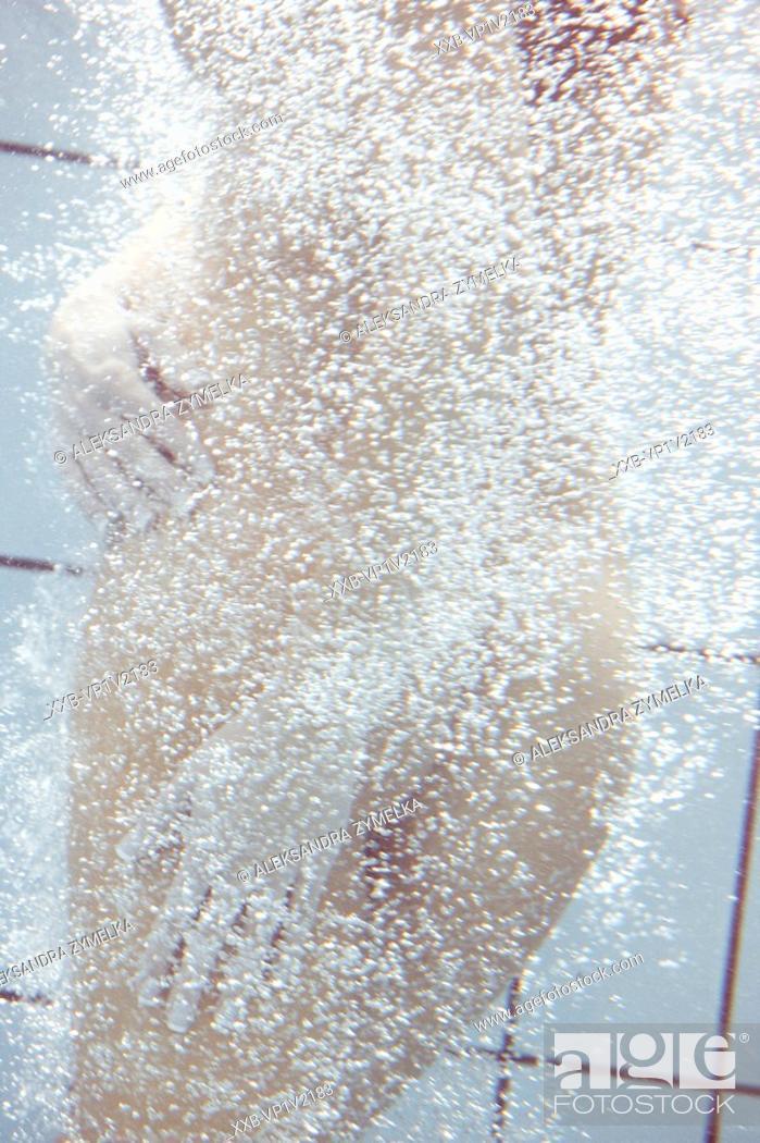 Stock Photo: nude woman in swimming pool.