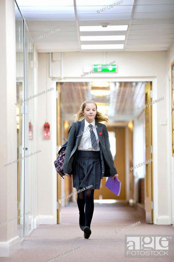 Photo de stock: Portrait middle school student walking in school corridor.