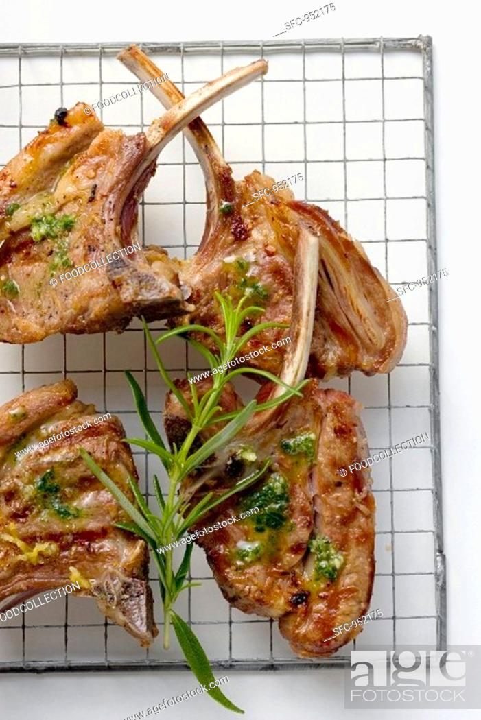 Stock Photo: Grilled lamb cutlets with herb oil and rosemary.