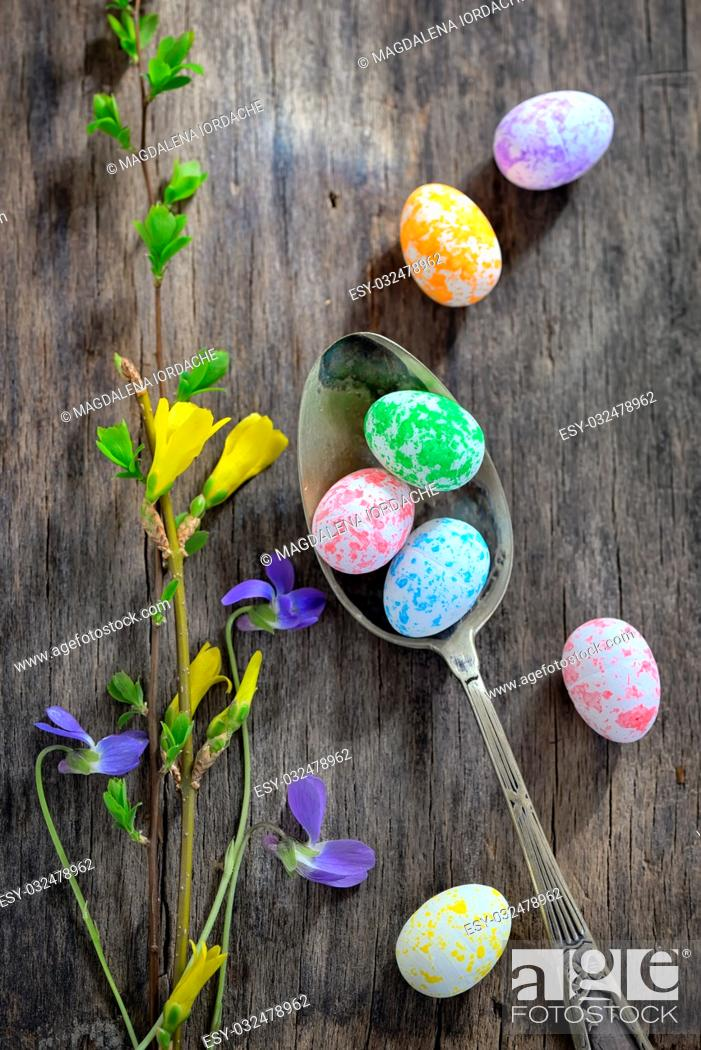 Stock Photo: Easter wooden table setting with eggs and flowers.