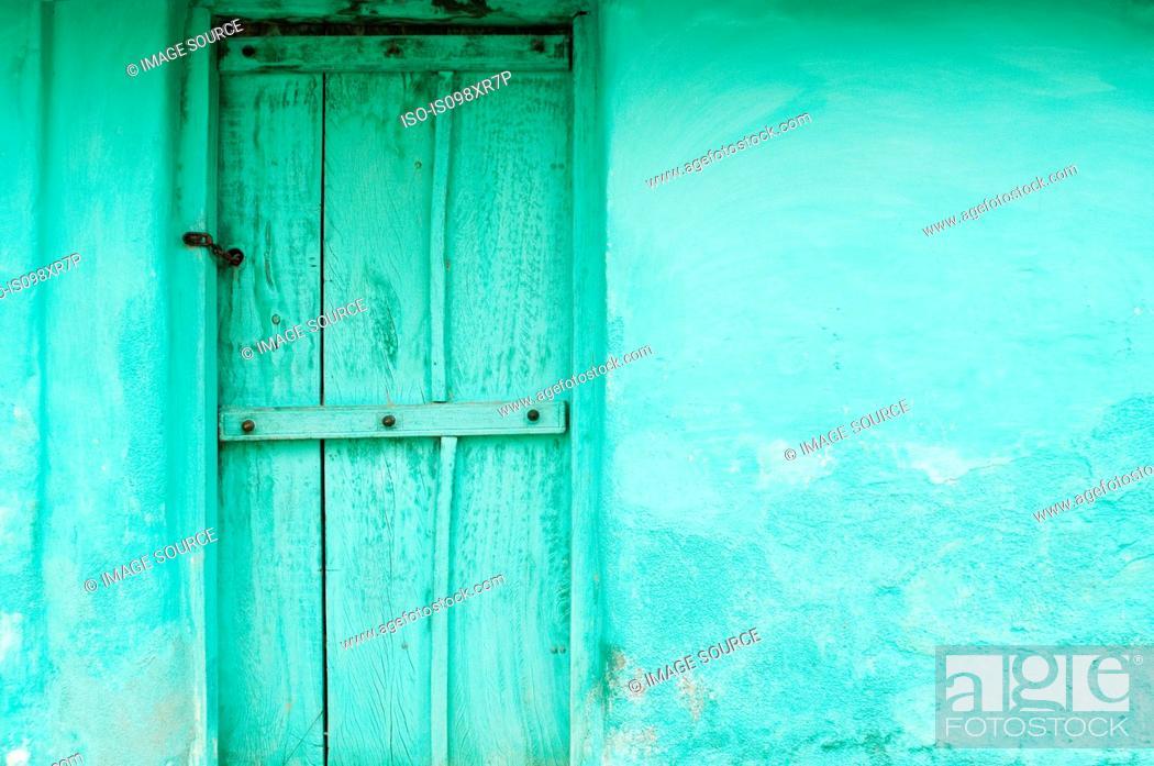 Stock Photo: Green wooden door and wall of village house near Mysore, Karnataka.