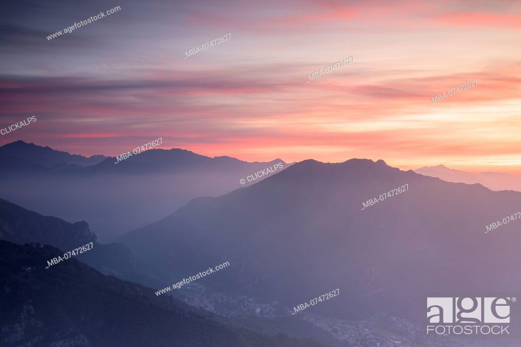 Stock Photo: Overview of Valsassina at sunrise from Monte Coltignone, Lecco, Lombardy, Italy.