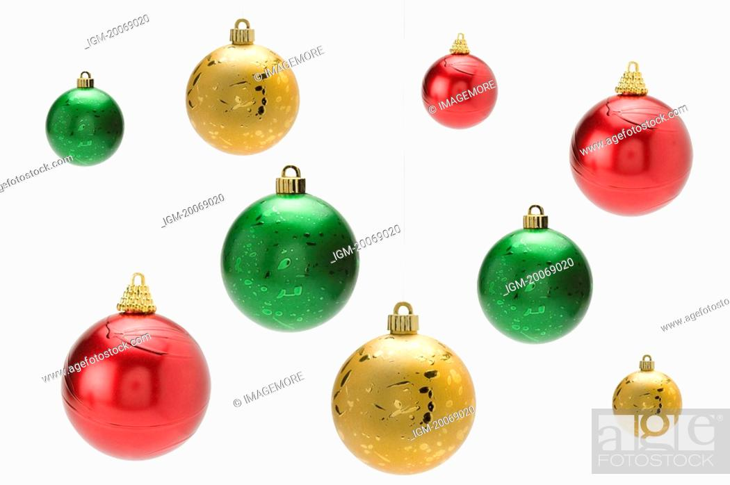 Stock Photo: Christmas baubles hanging mid-air.