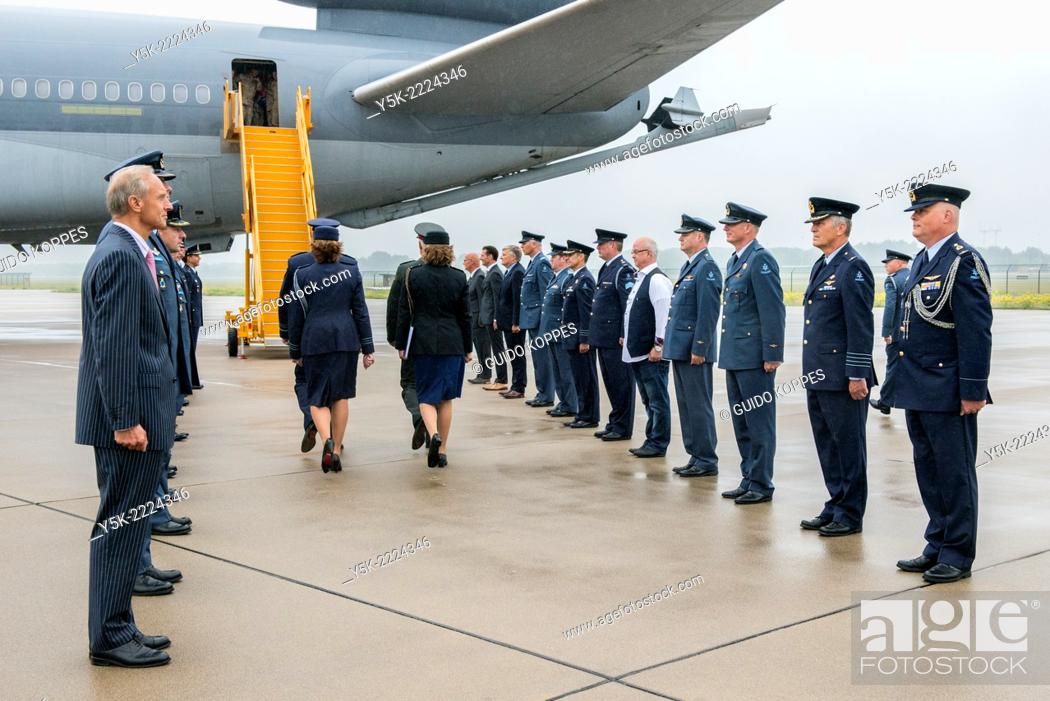 Stock Photo: Eindhoven Airbase, Eindhoven, Netherlands. Two rows of military commanders lined up opposite of each other at the rear exit of a KDC-10 military airplane.