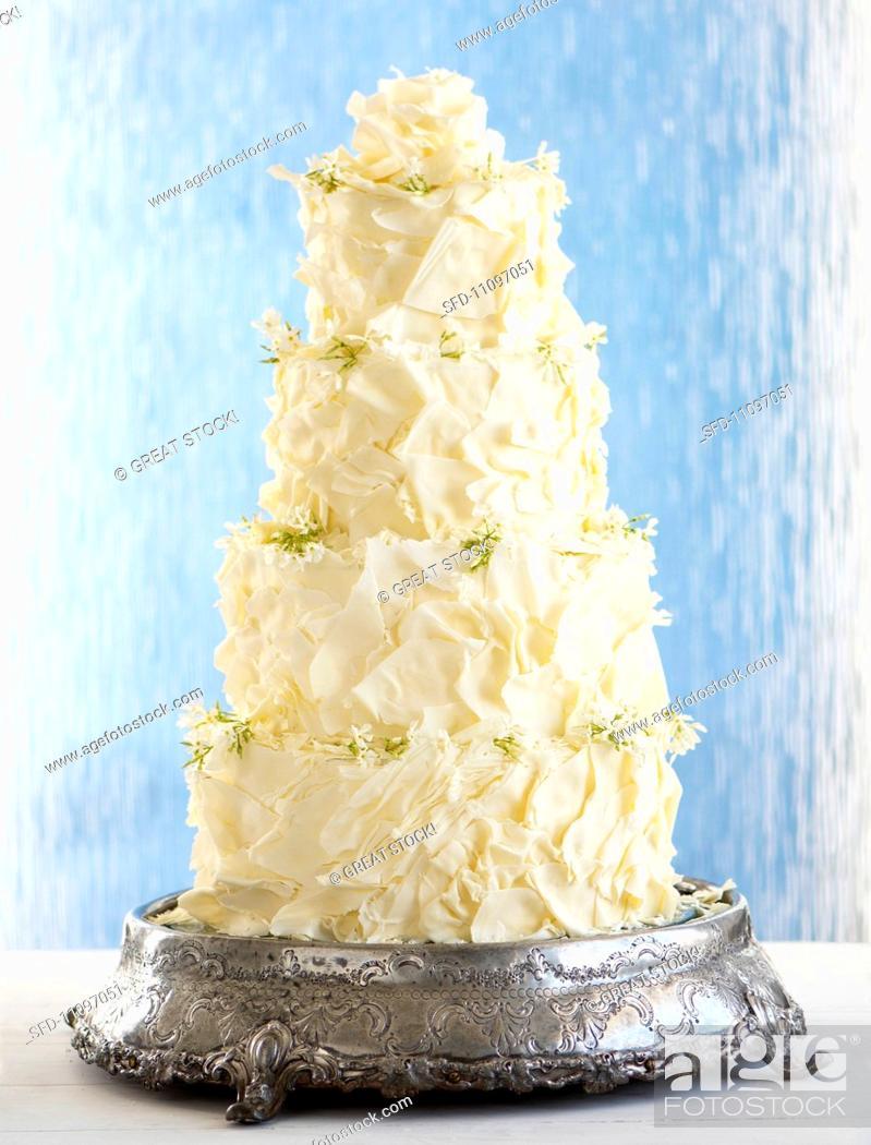 Multi Tier Wedding Cake With Ganache And White Chocolate Stock