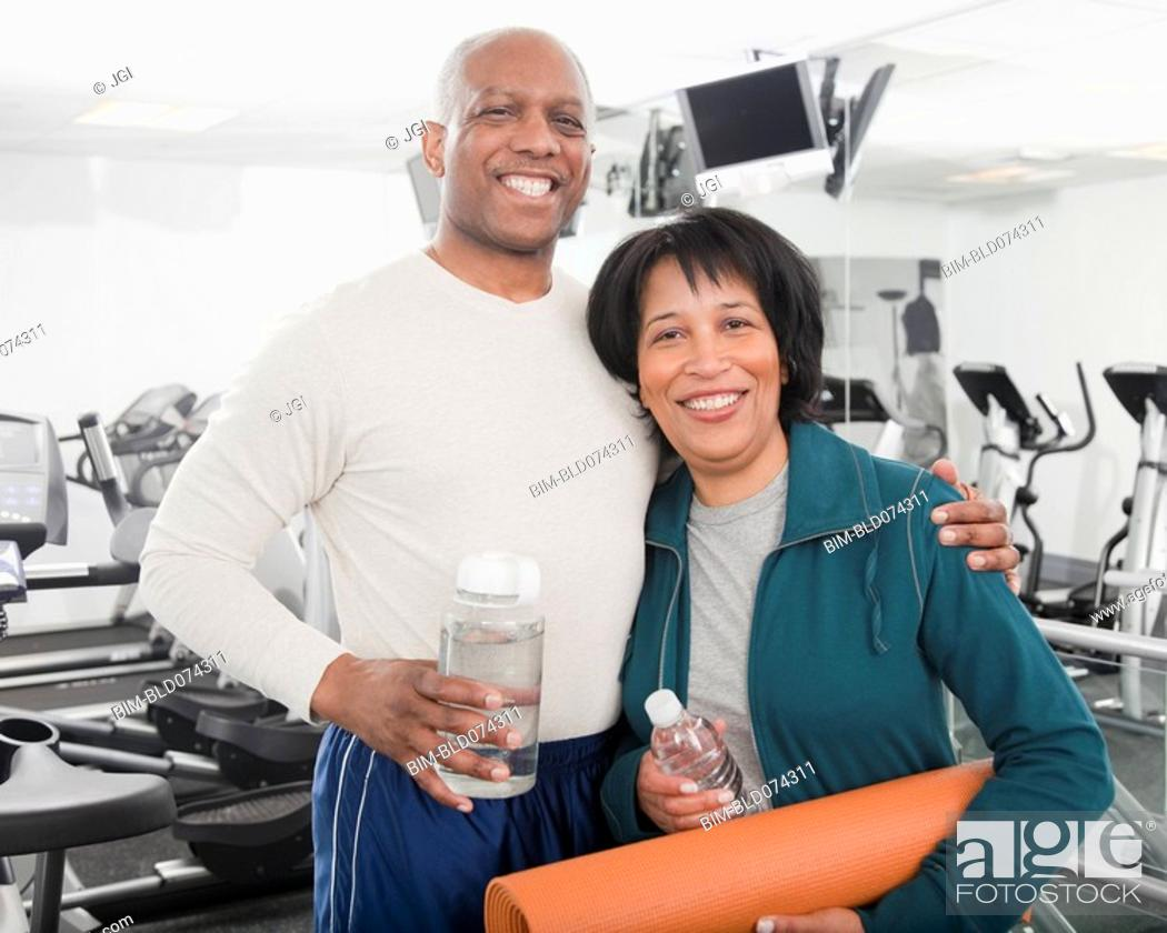 Stock Photo: African couple standing in health club.