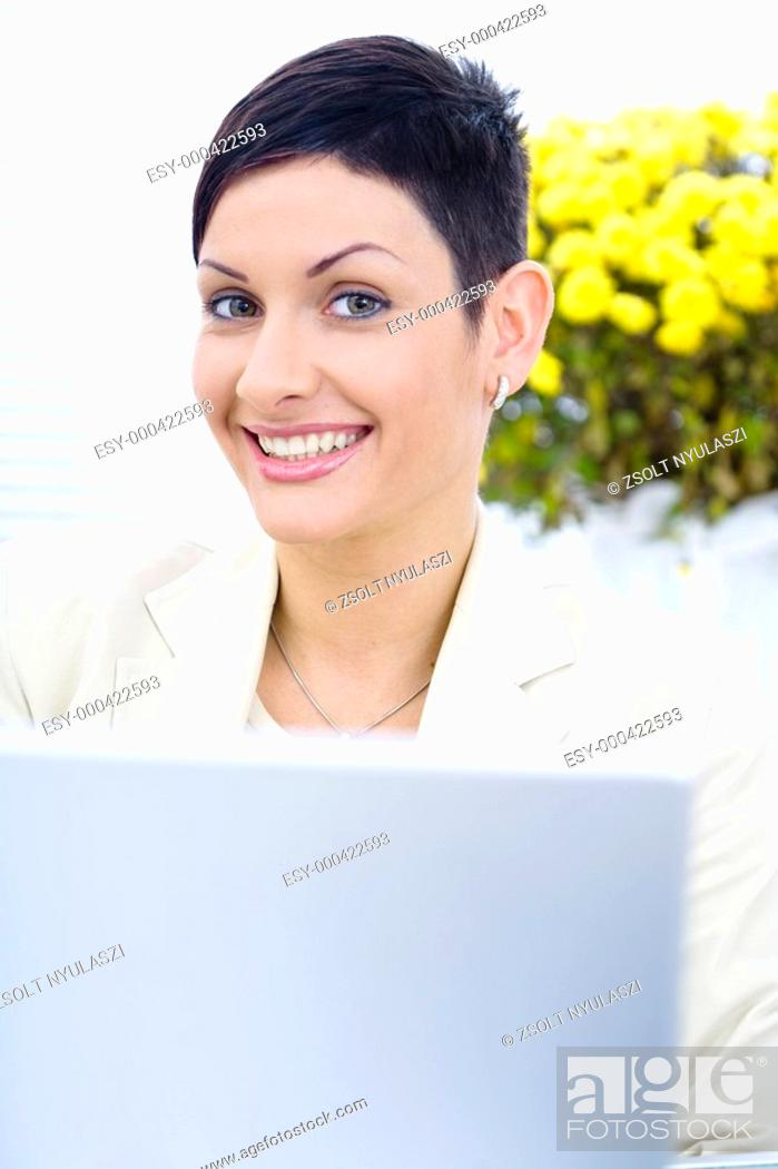 Stock Photo: Businesswoman working on laptop.