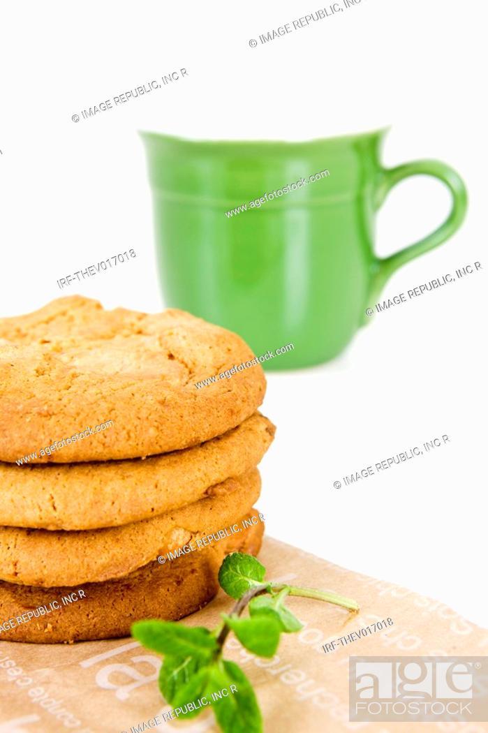 Stock Photo: cookies on paper bag and mug.