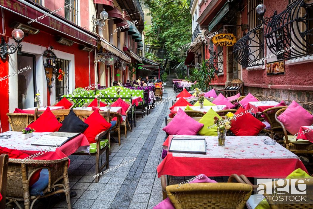 Imagen: Colorful restaurants with tables and chairs and the unique Cezayir or French Street in Taksim, Istanbul, Turkey, Eurasia.