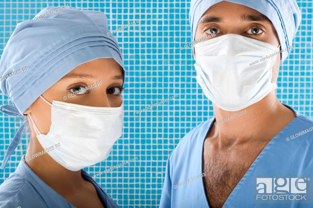 Stock Photo: Close-up of a male surgeon and a female surgeon.