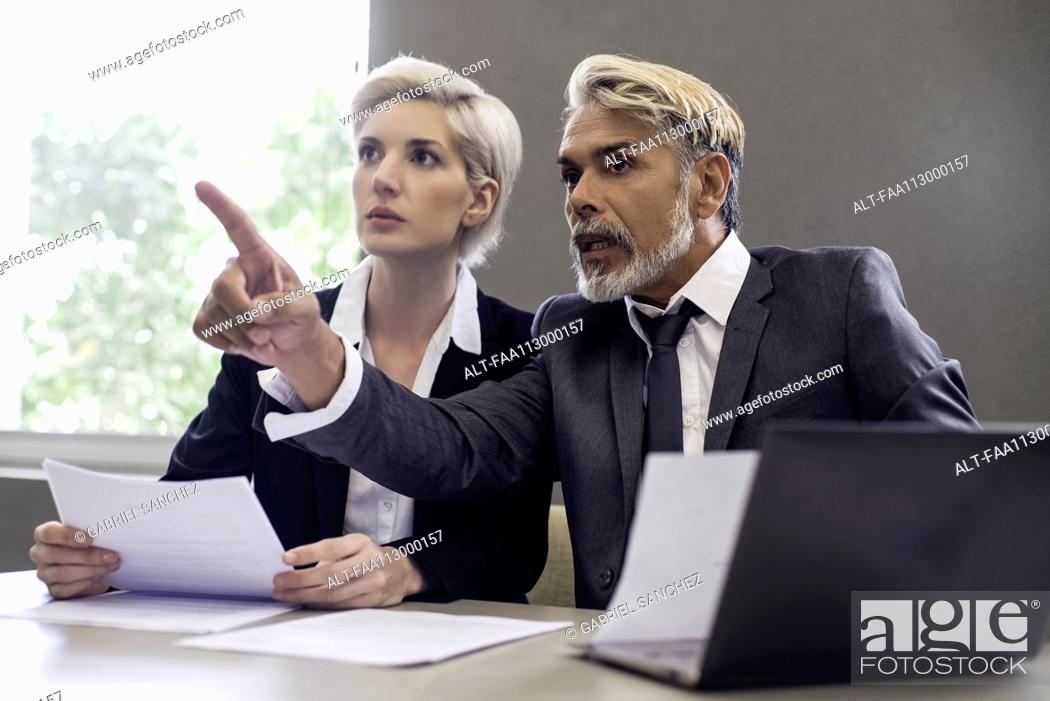 Photo de stock: Business people working together in office.