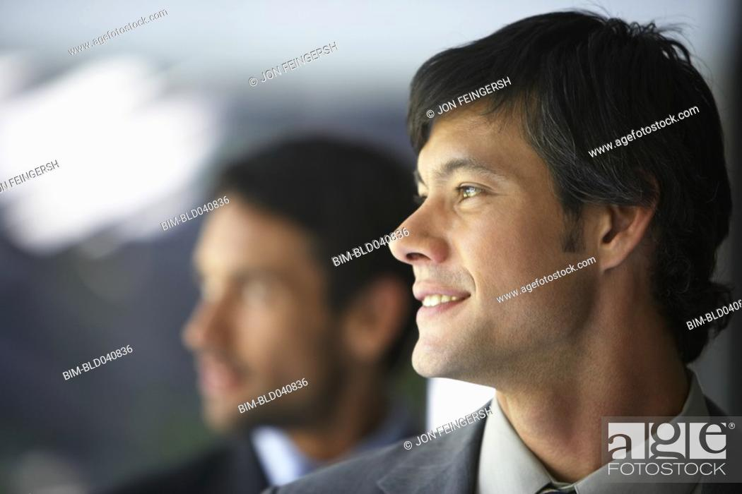 Stock Photo: South American businessman looking to side.