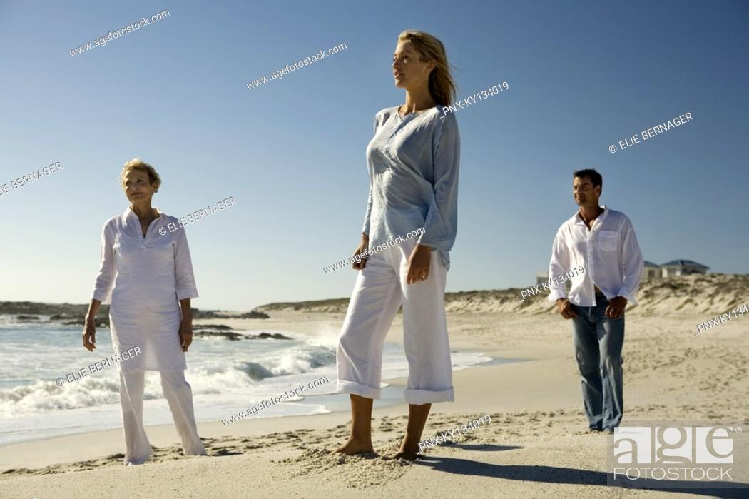 Stock Photo: Couple and senior woman on the beach.