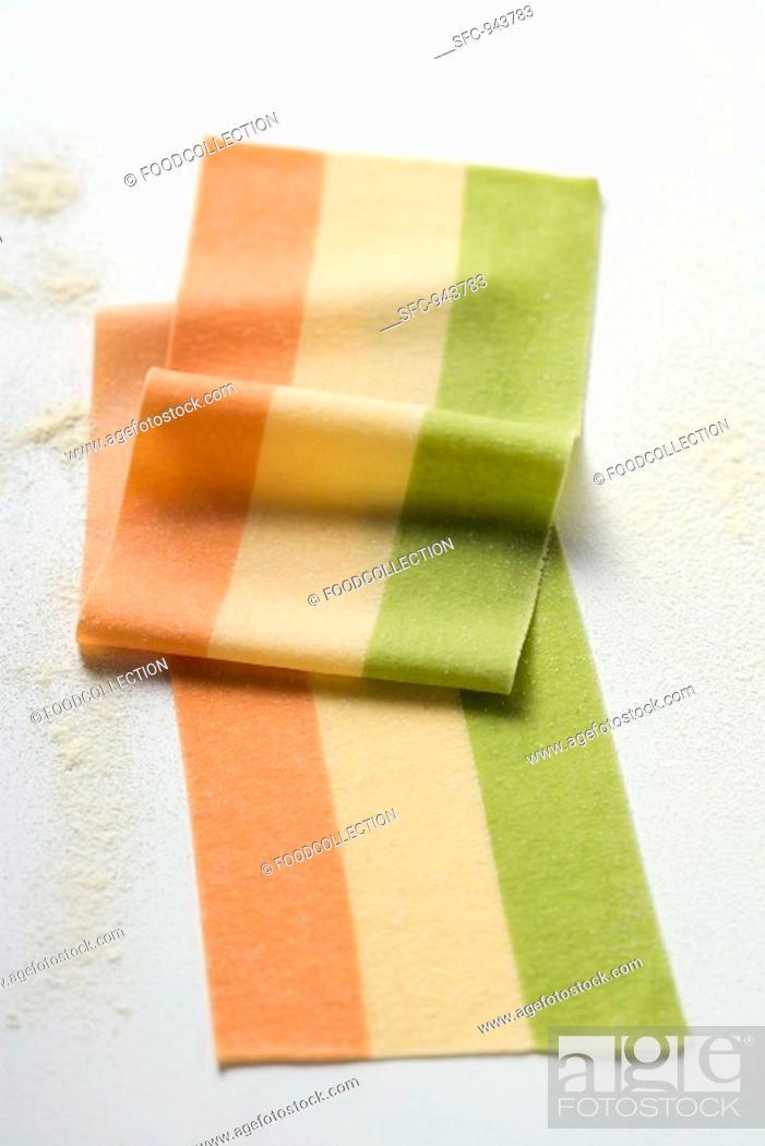Stock Photo: Striped pasta dough in three colours.