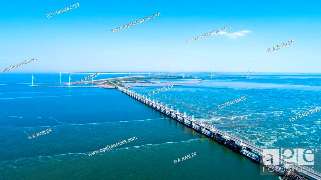 Stock Photo: Oosterschelde flood barrier with windmills in the Netherlands at the Northern Sea taken from above with a drone.