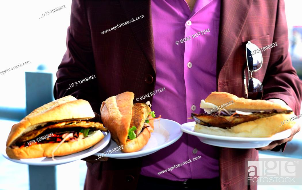 Stock Photo: The famous fish sandwiches served under and near the Galata bridge in Istanbul.