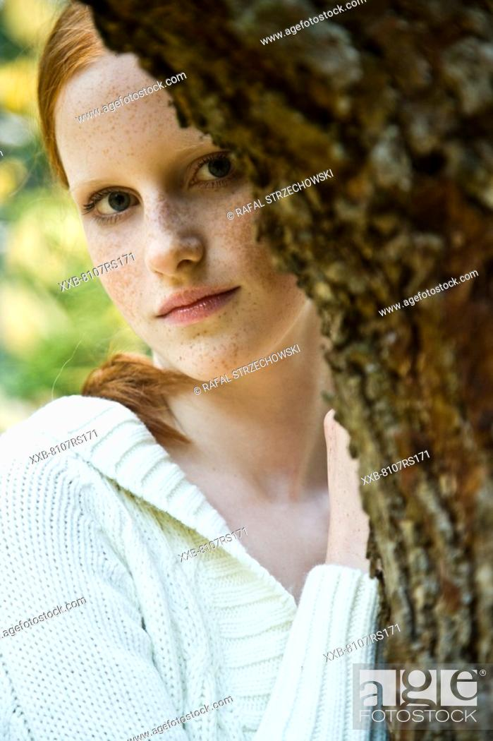 Stock Photo: Young woman in autumn landscape.
