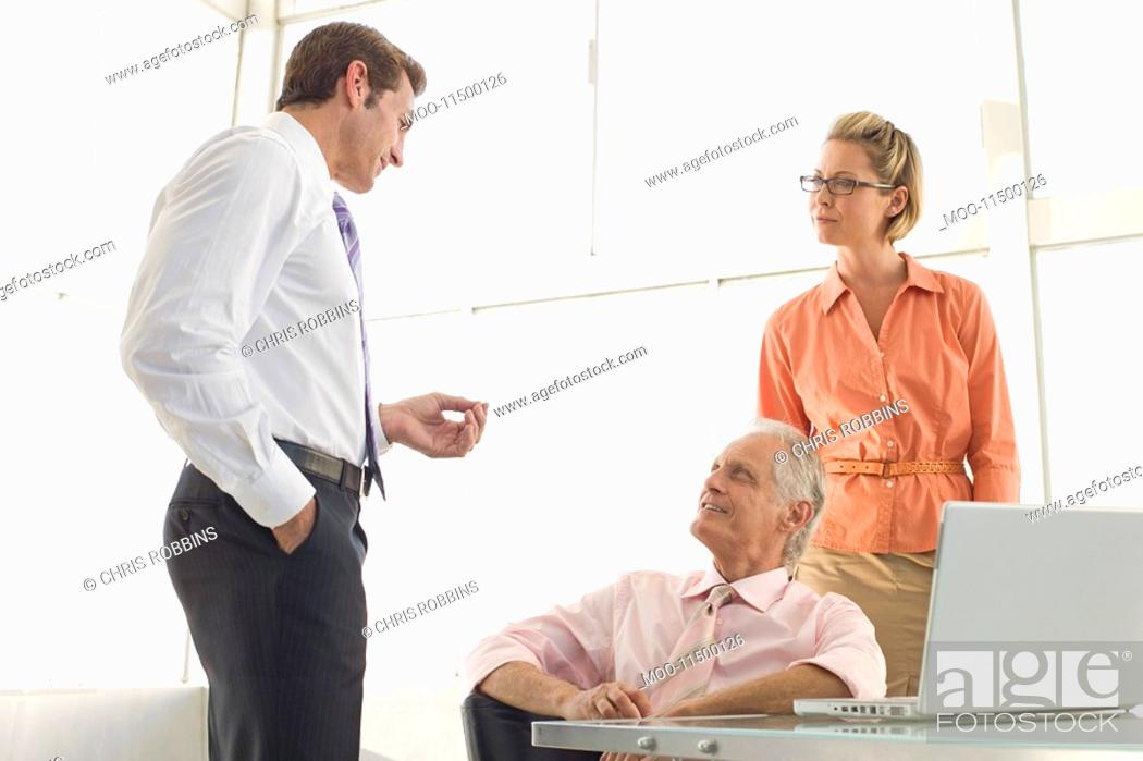 Stock Photo: Business colleagues working in conference room.