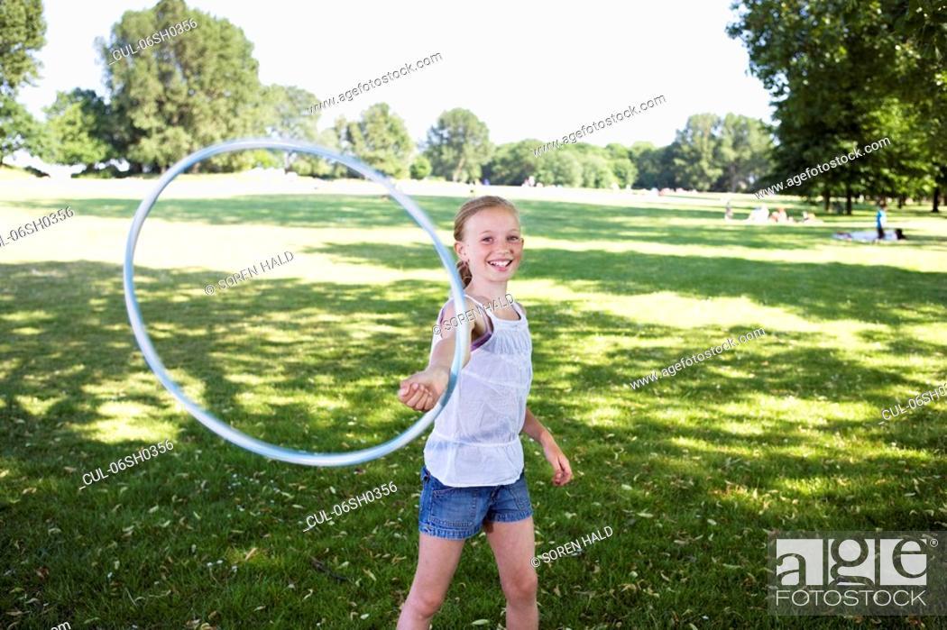 Stock Photo: Girl with hula-hoop.