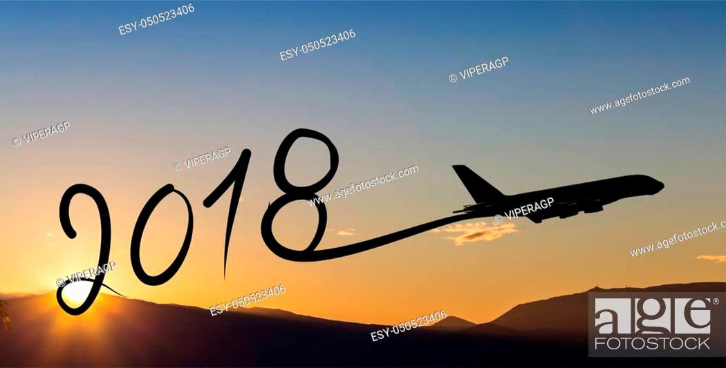Stock Photo: New year 2018 drawing by airplane on the air at sunset.