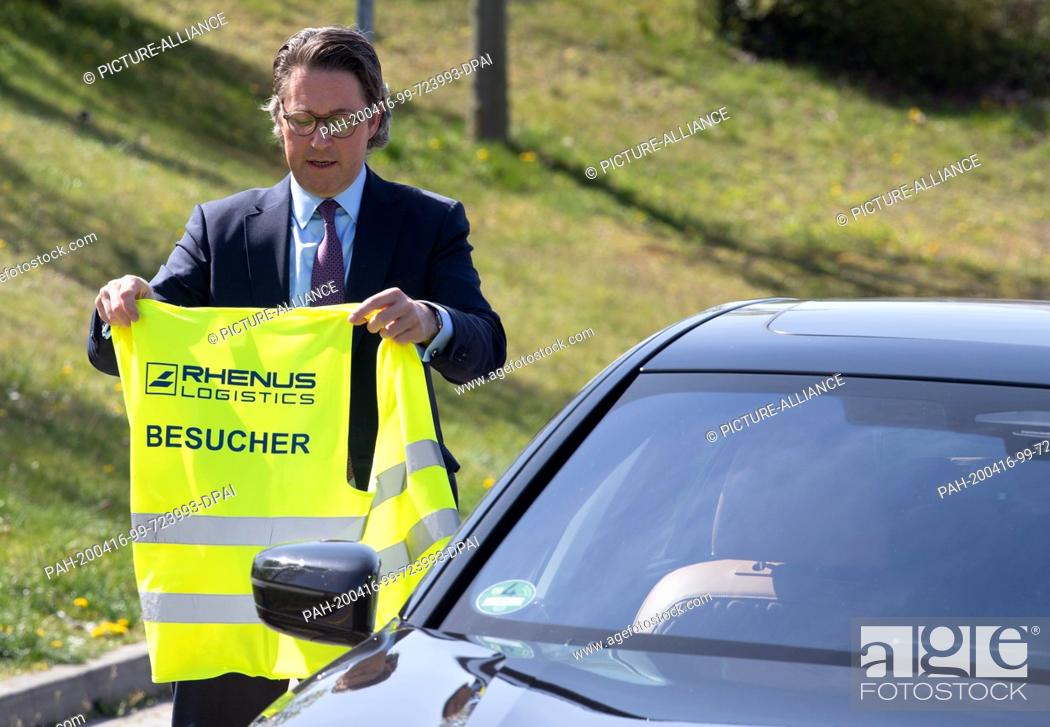 Stock Photo: 16 April 2020, Brandenburg, Großbeeren: Federal Minister of Transport Andreas Scheuer (CSU) is given a brief introduction to the logistics service provider.