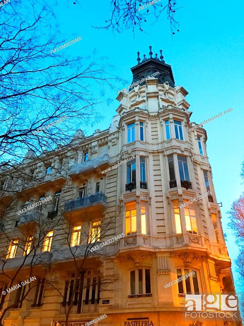 Stock Photo: Facade of building, night view. Alcala street, Madrid, Spain.