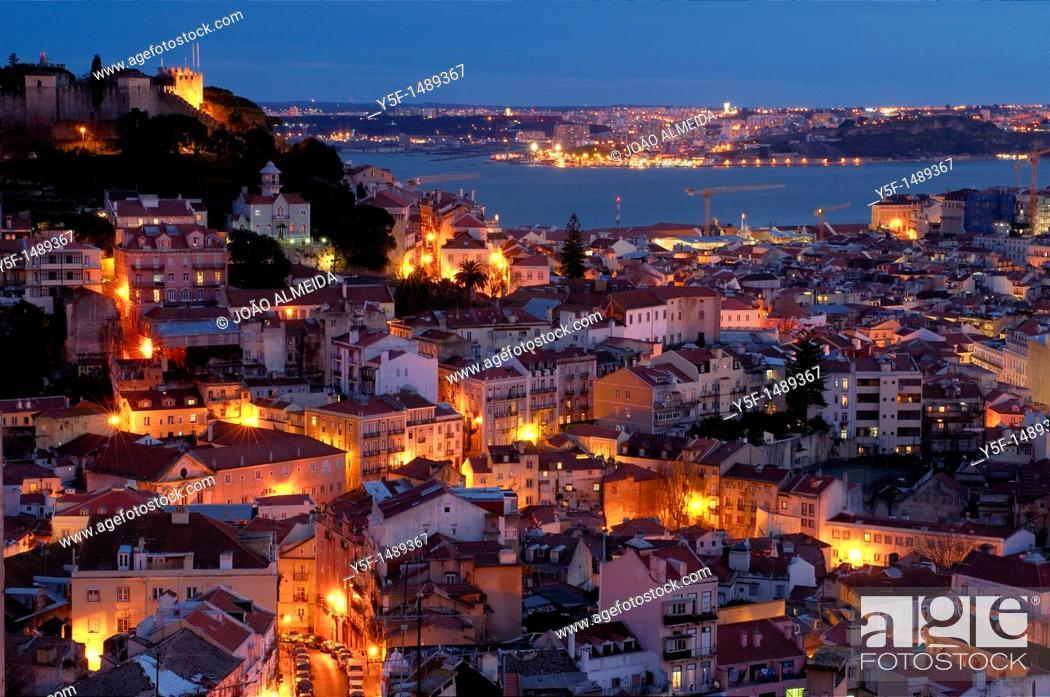 Stock Photo: View of Lisbon's downtown and martim Moniz square with river on the background.