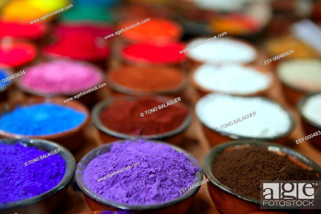 Stock Photo: colorful powder pigments in rows in clay bowls.