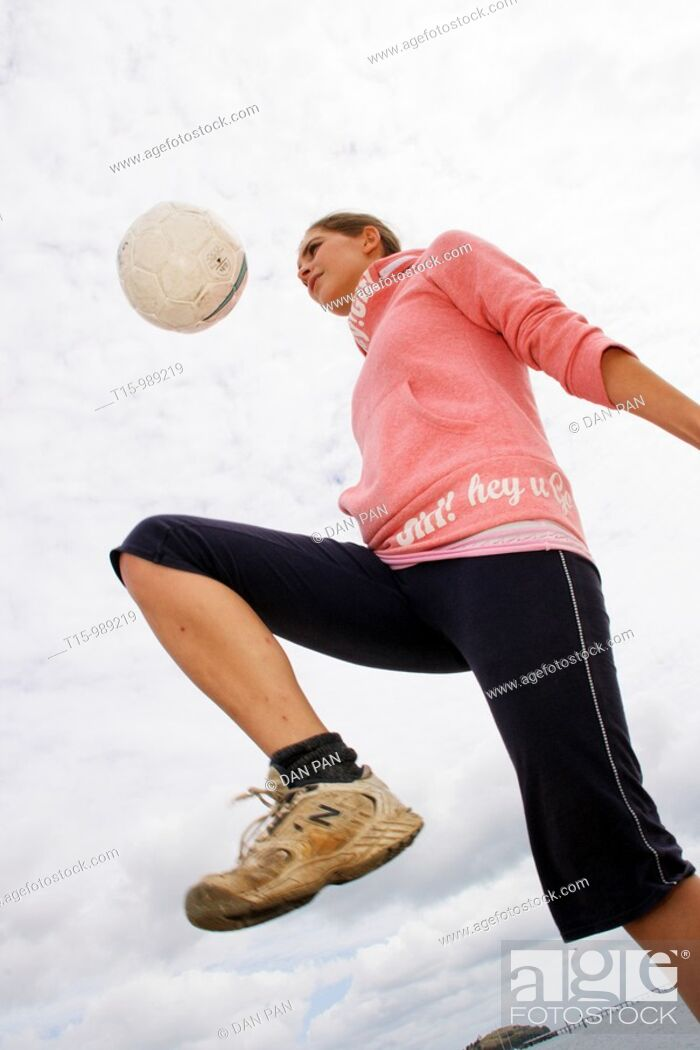 Stock Photo: A woman with a soccer ball.